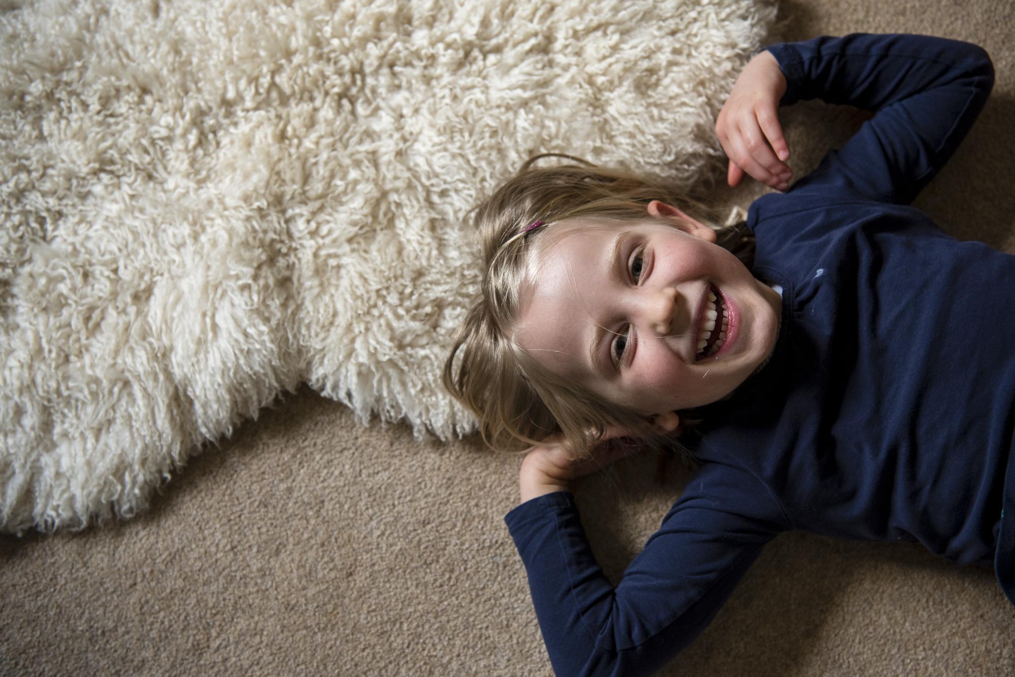 sally-hornung-photography-client-girl-on-rug.jpg