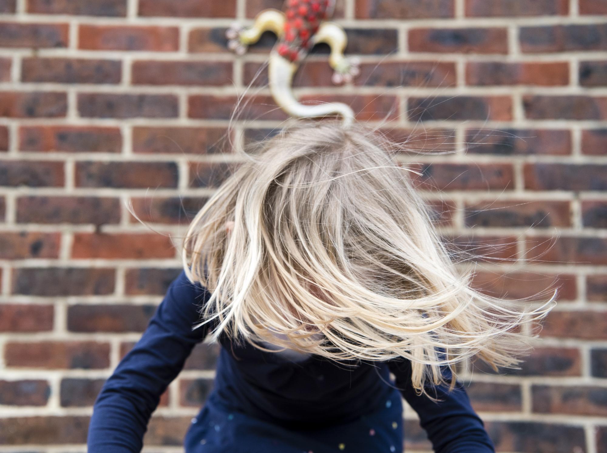 sally-hornung-photography-girl-twirling-hair.jpg