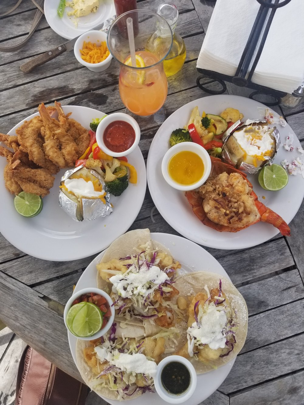 Photo Taken By Me : One of my favorite meals in Cancun. Brittany and I decided to share a few plates. We had fish tacos, lobster tail and fried shrimp.