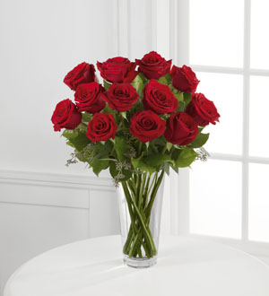Dozen Red Roses Arrangement- 12 red roses arranged in a vase with beautiful greenery. (125)