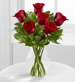 Half Dozen Red Rose Arrangement- 6 red roses arranged in a vase with beautiful greenery. ($75)