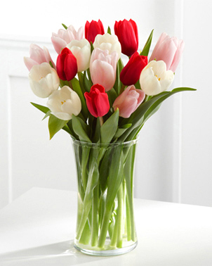 Ten Tulips Arrangement - 10 mixed coloured tulips arranged in a vase with beautiful greenery. ($60) *Colours may vary from photo, depending on availability.*