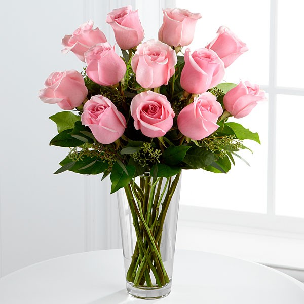 Dozen Roses Arrangement- 12 roses arranged in a vase with beautiful greenery. ($110)