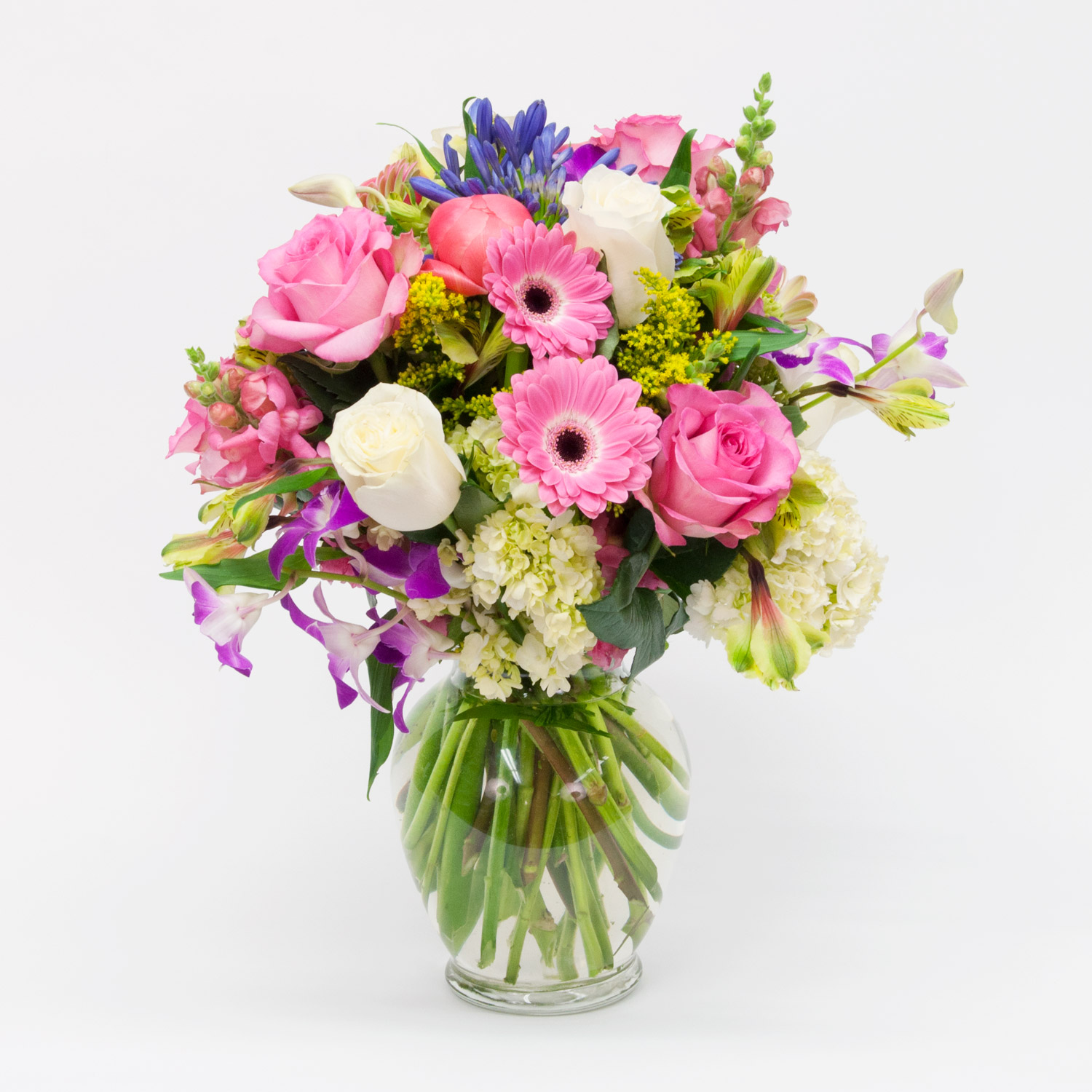 Mixed Flower Arrangement 2 - a lovely mix of fresh cut flowers, including gerbera daisies, roses, snaps, etc. arranged in a vase with beautiful greenery. ($120 and up)