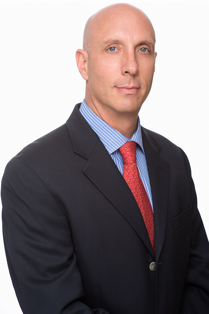 Corporate Headshot of Client, Gregorio. His company needed new headshot to appeal to high level investors. Nailed it!