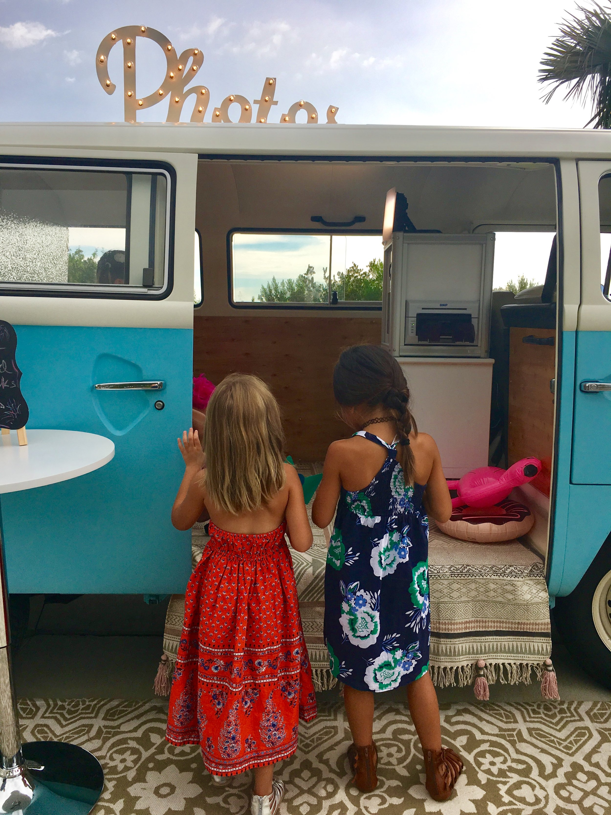 Girls playing in the VW Photo Bus on Anna Maria Island