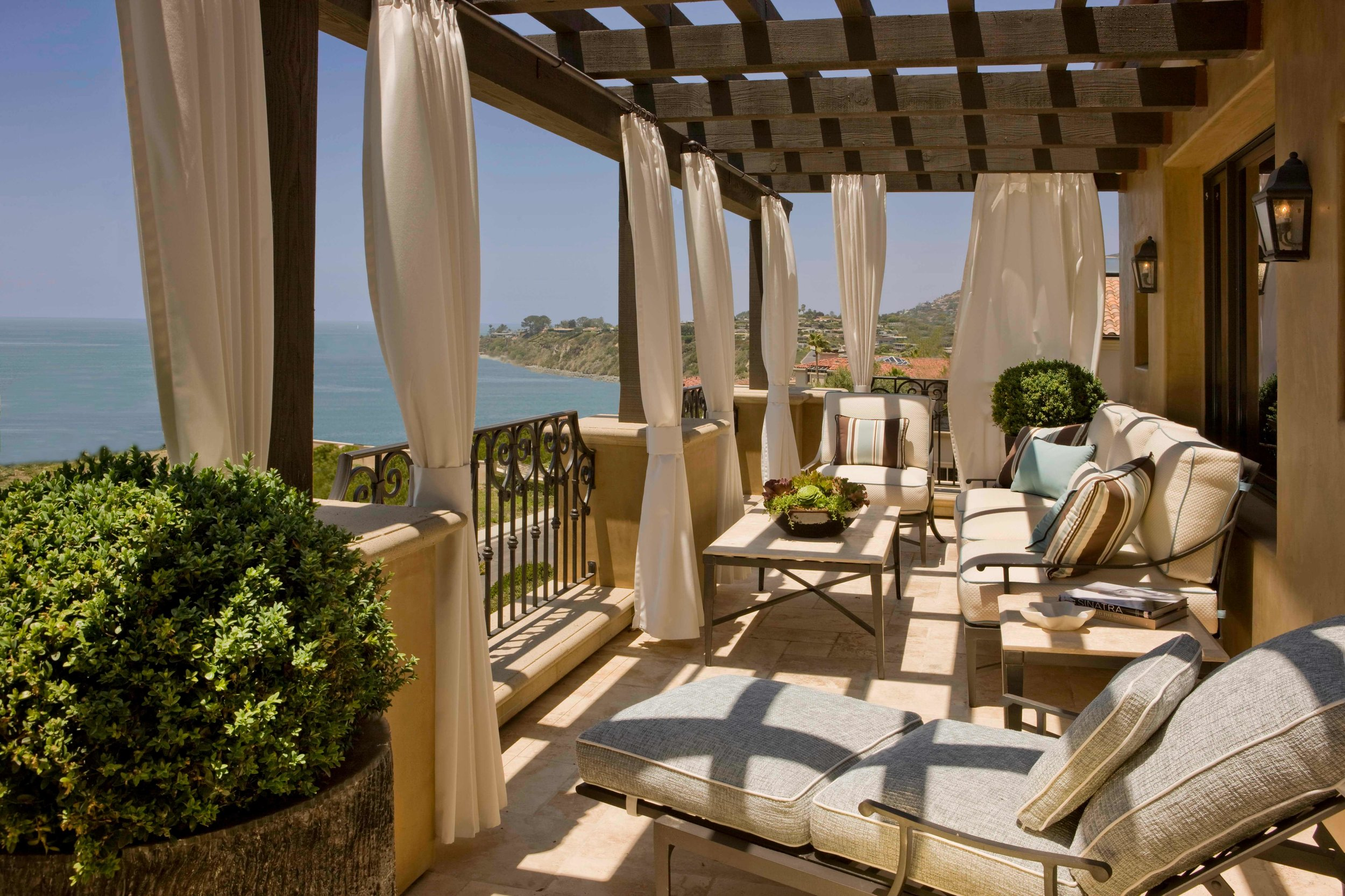 elizabeth-tapper-interiors-ritz-cove-laguna-exterior-outdoor-lounge-oceanfront-deck-view-draped-pergola.jpg