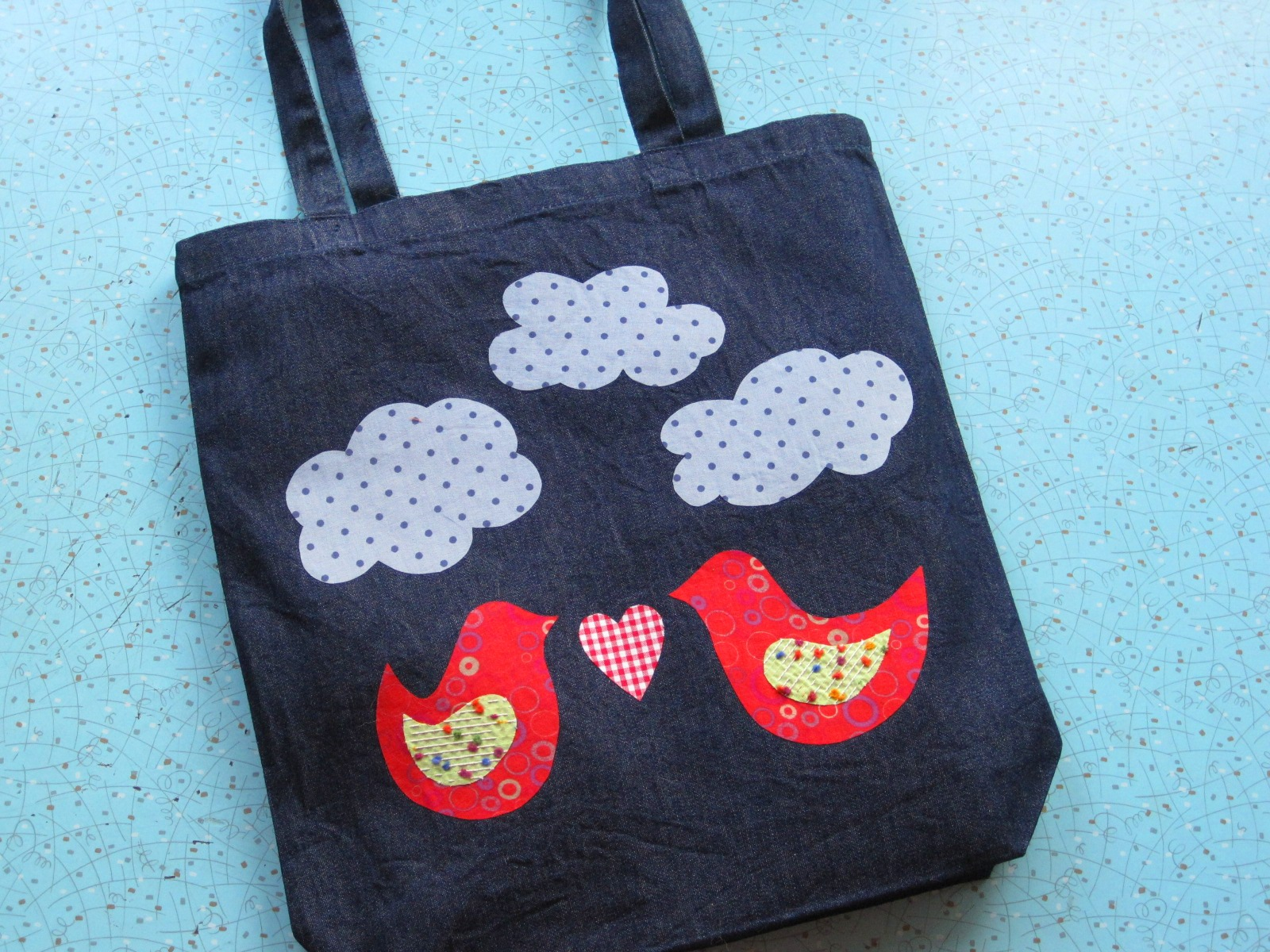 Tote-ally Awesome 2.0 - ages 7 and up - Kids will learn how to embellish a denim tote bag using a no-sew iron-on, (we like to call it magical!), applique technique.  We'll provide the tote bag and the fabric, (not to mention sparkles, trims, google eyes, buttons and pom poms!). You provide the inspiration!