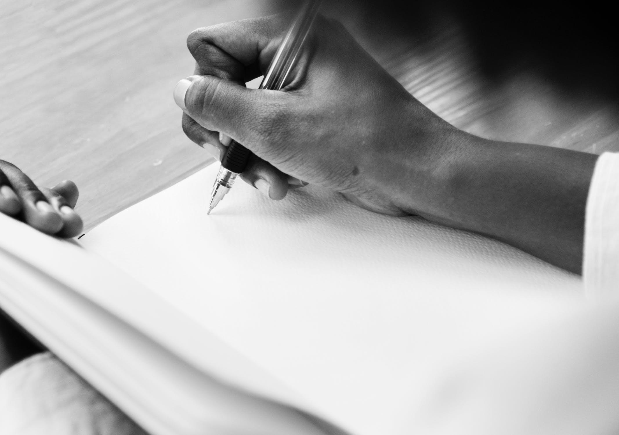 Woman writes in blank notebook