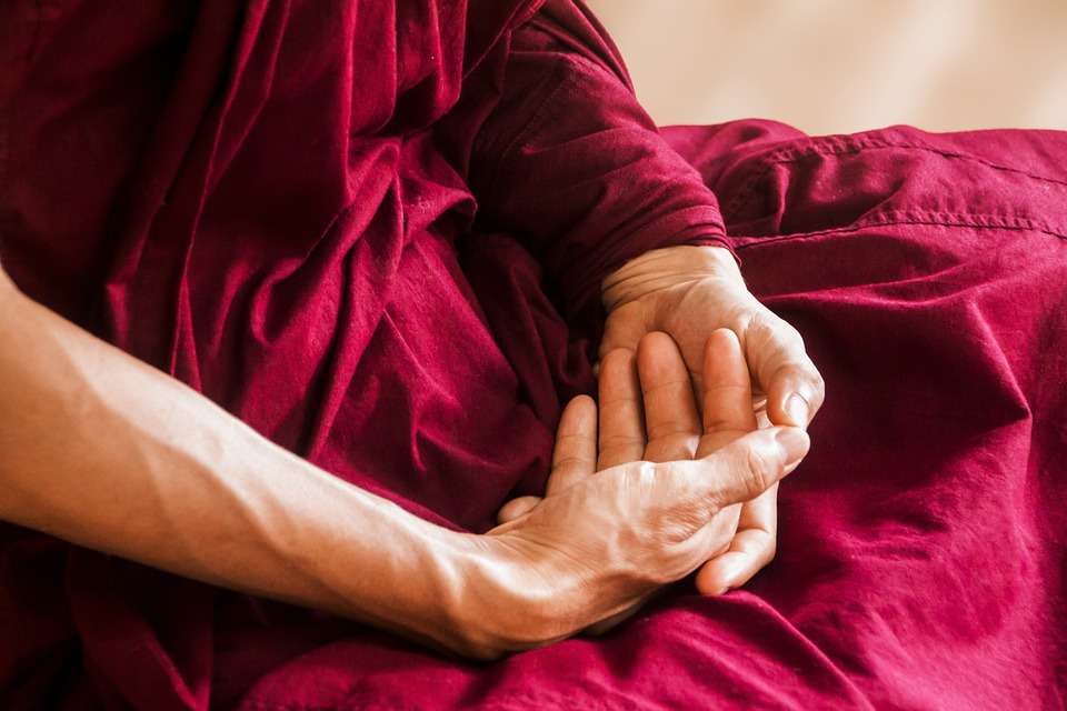 Meditation Instructor Rests His Hands in His Lap