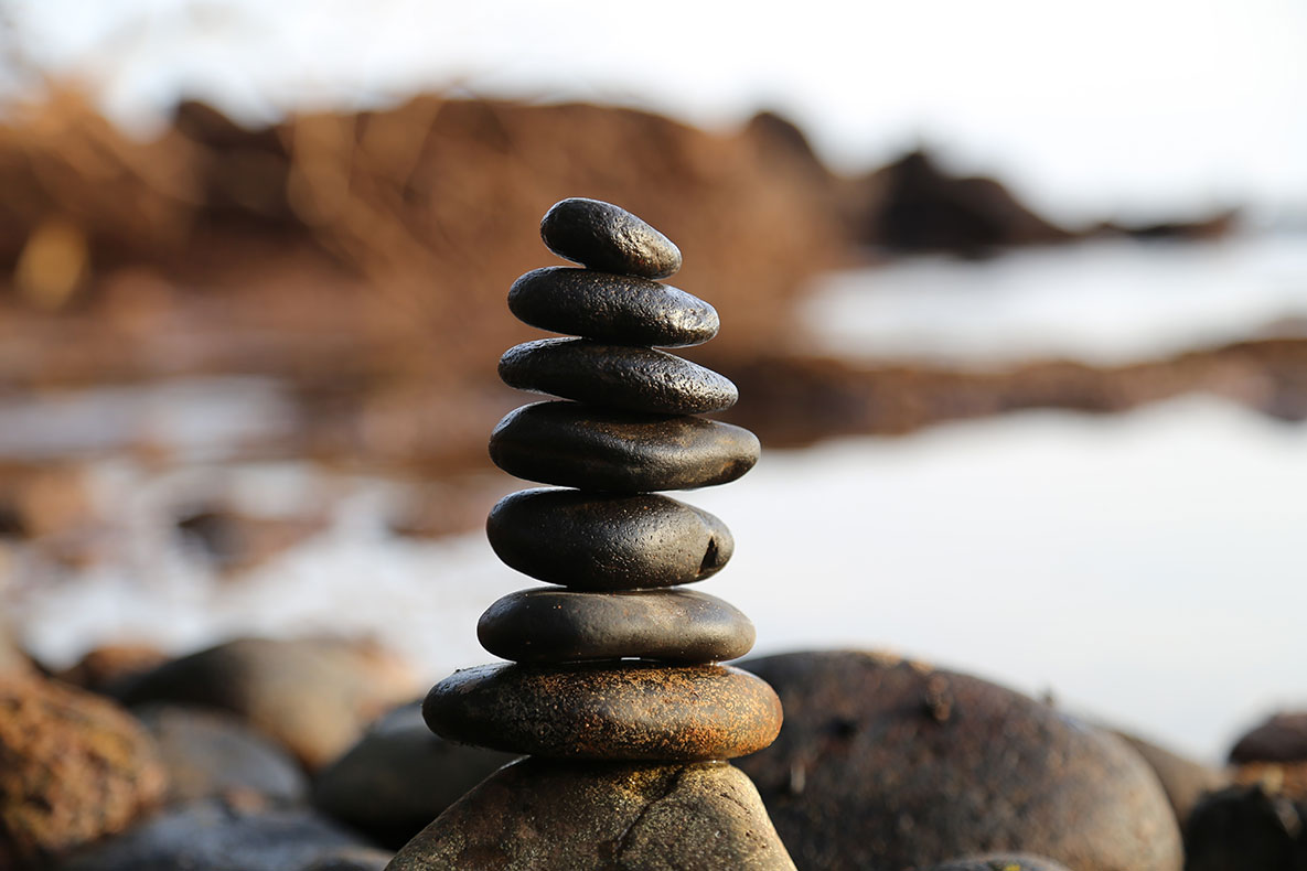 Stacked rocks near a beach