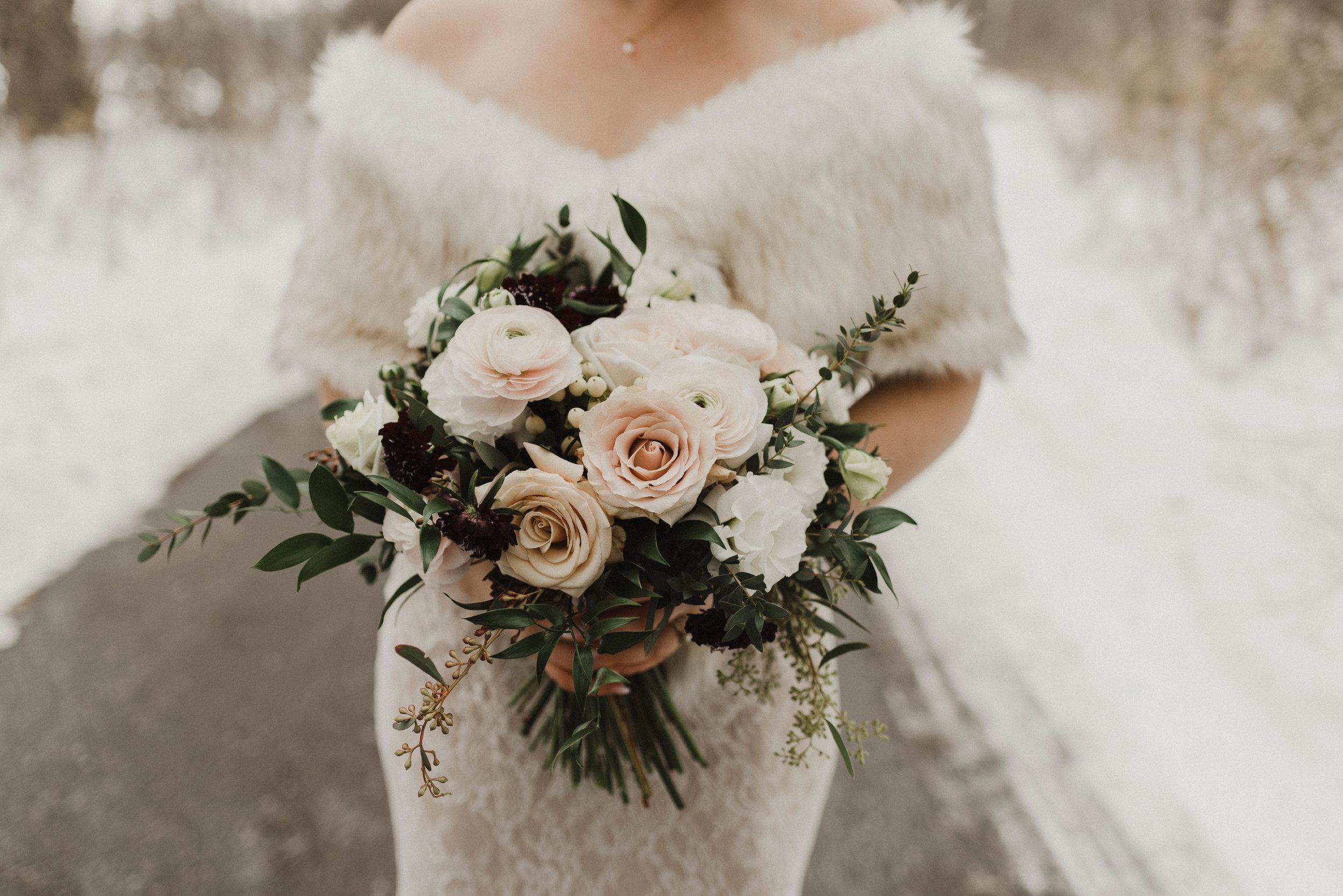 Elegant bridal bouquet for Canadian winter wedding.