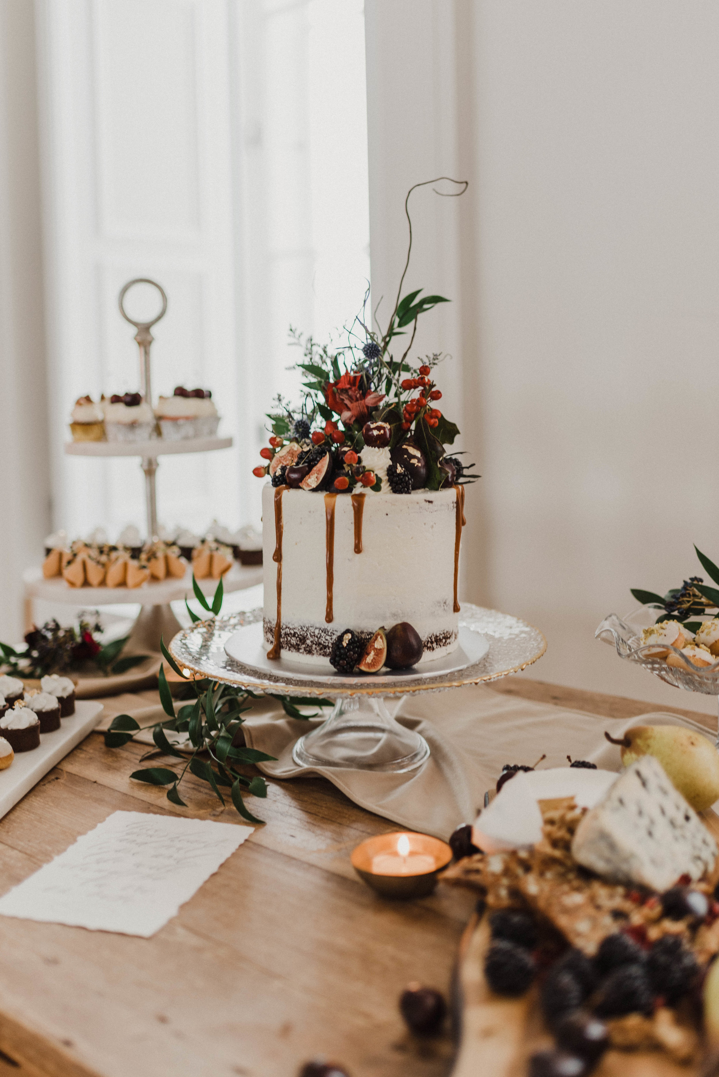 Delicious wedding cake and assorted desserts
