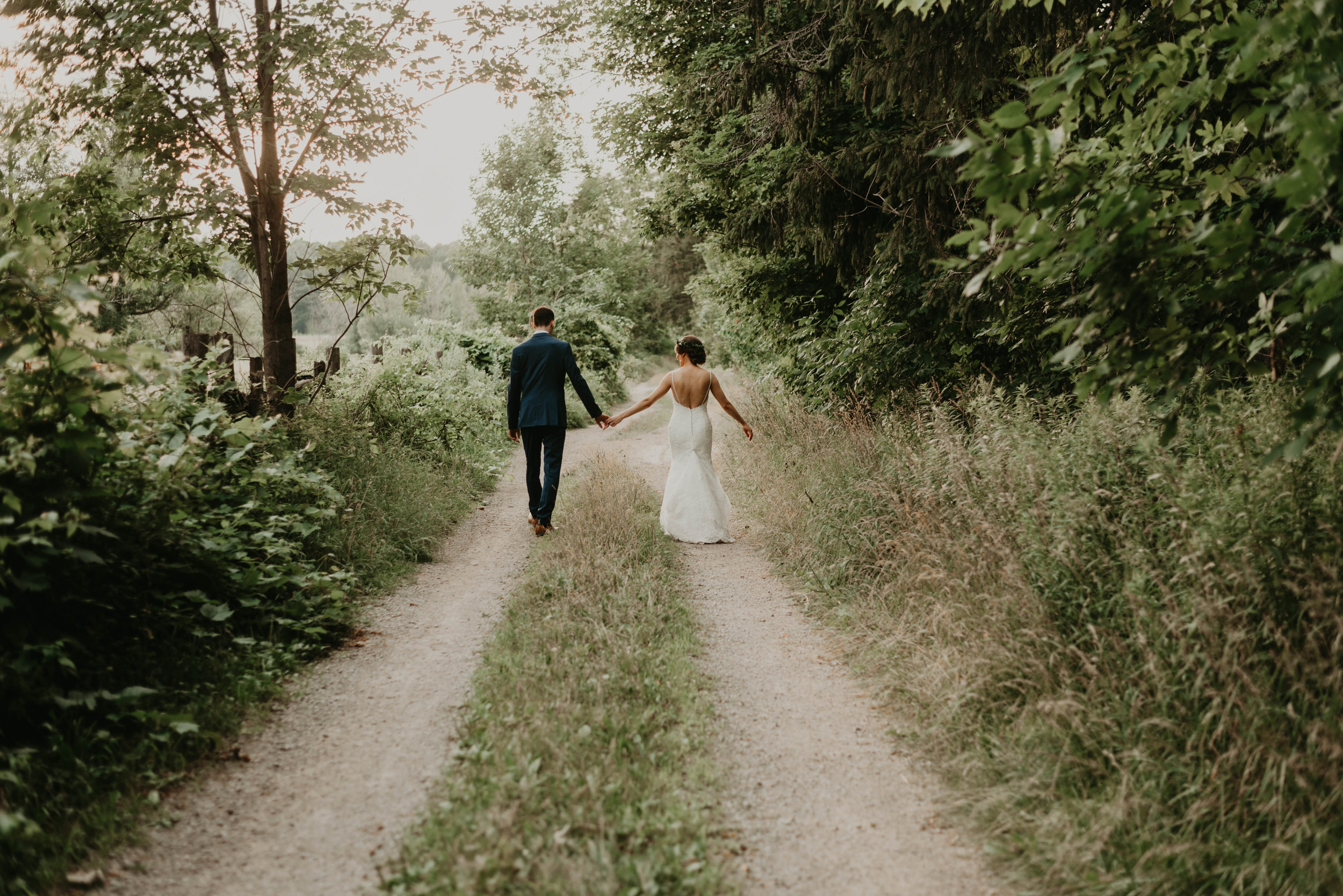 Bride and Groom taking a wedding day stroll.