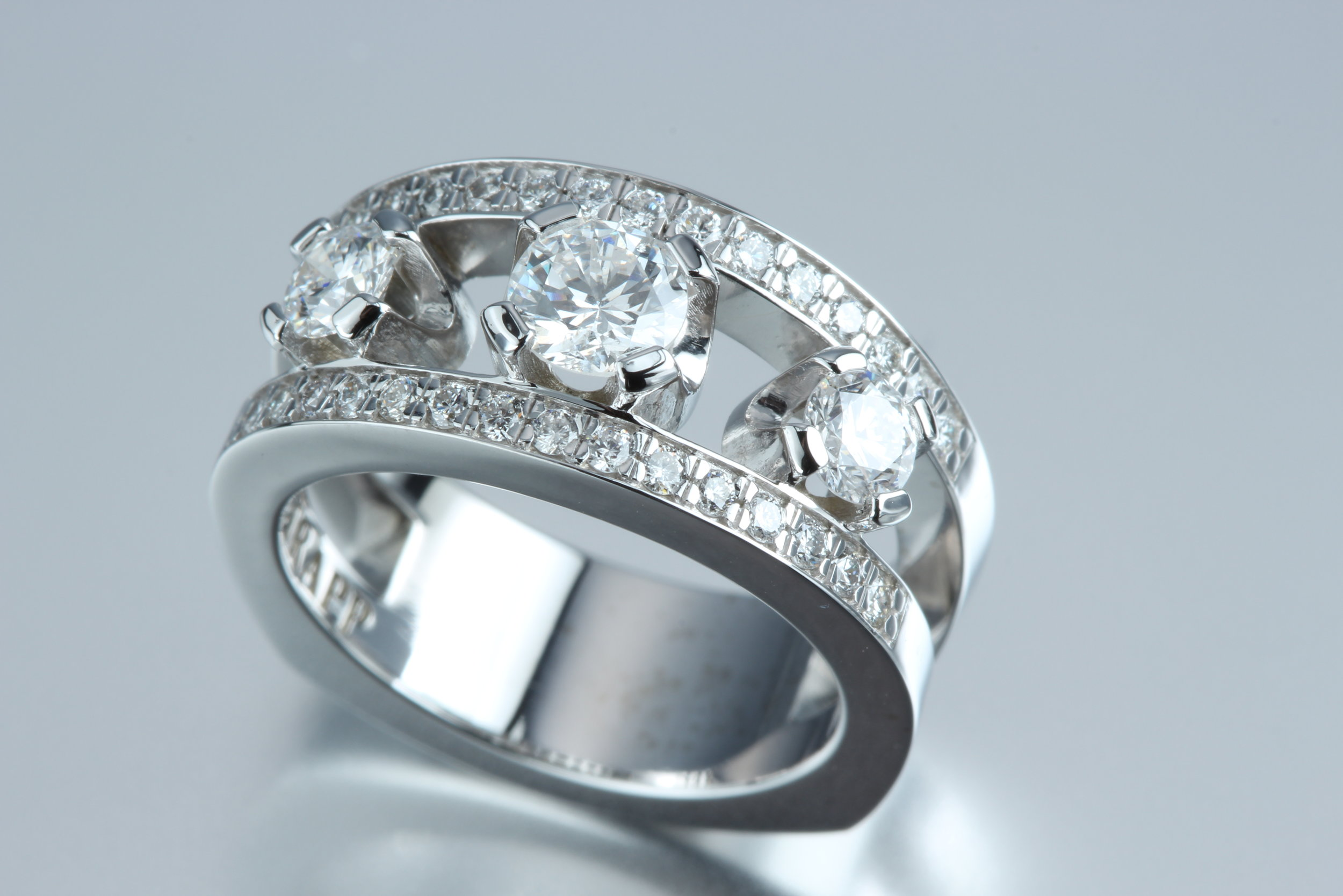 Triple Diamond Ring with 14K White Gold - This triple diamond ring glistens from all angles. It is made with all genuine diamonds and 14k white gold.