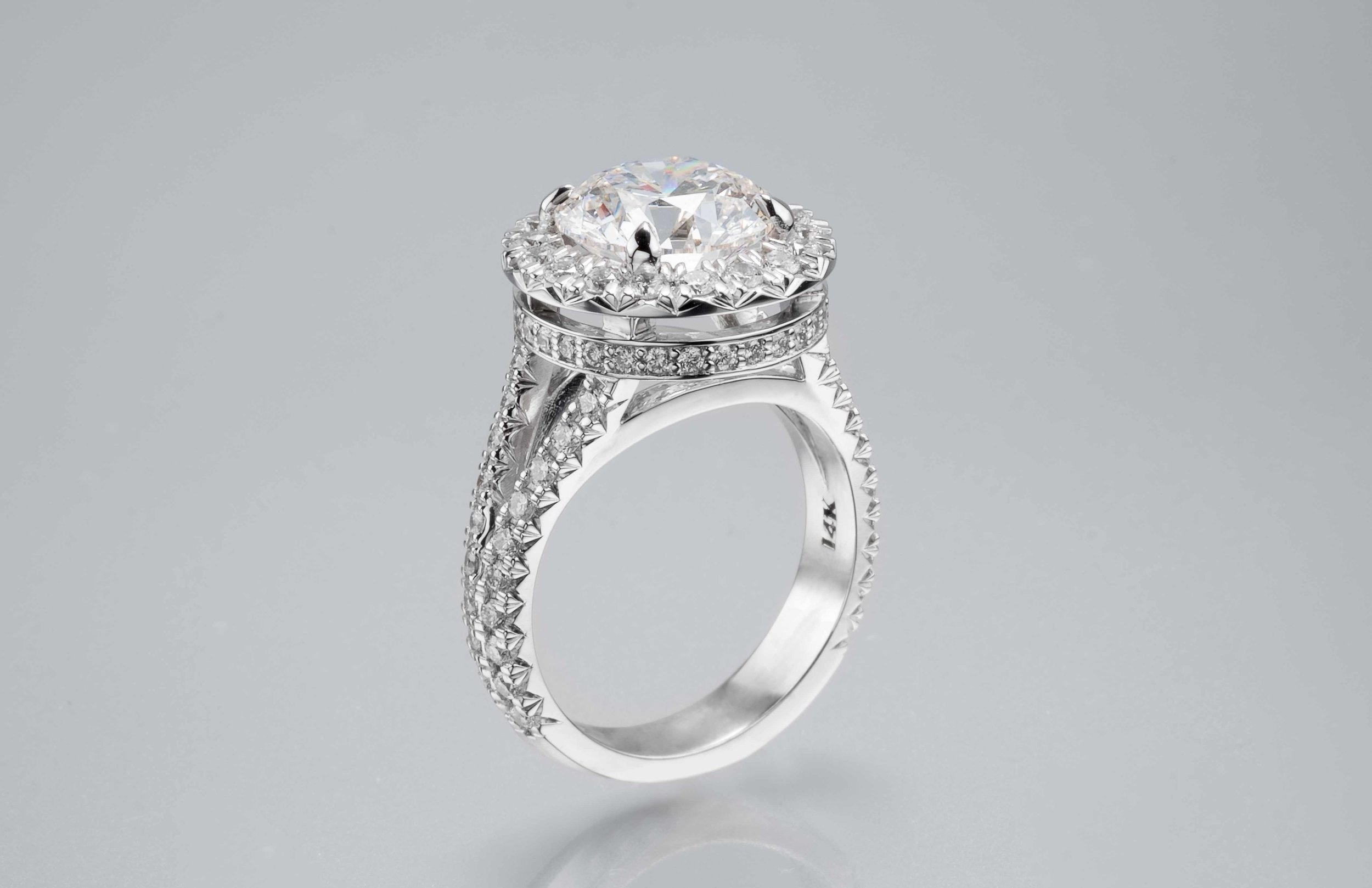 3 Carat French Cut Double Halo Ring in 14K White Gold - This intricate, handmade ring is truly a stunning piece.