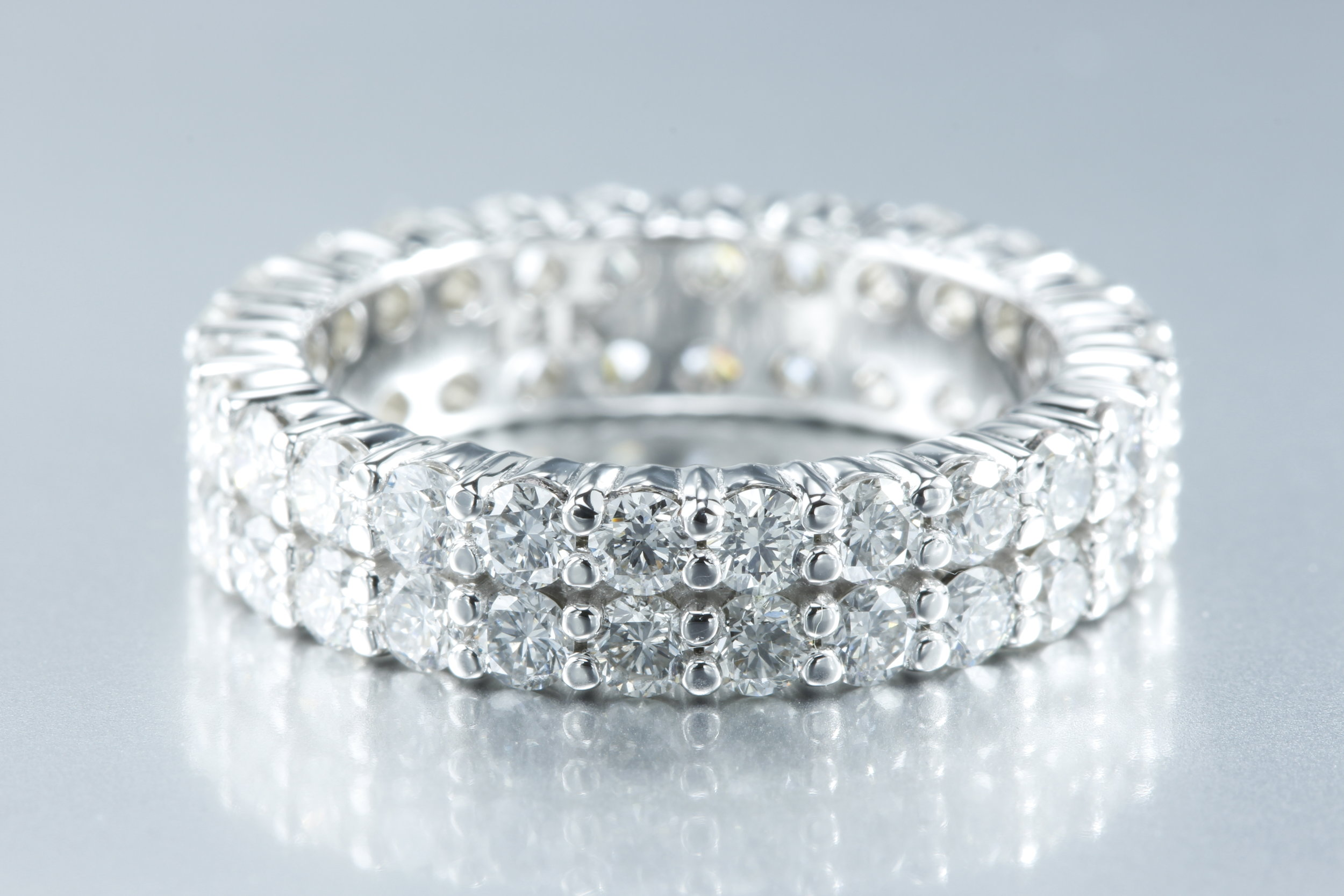Double Row Diamond Ring - Genuine diamonds around both bands in platinum.