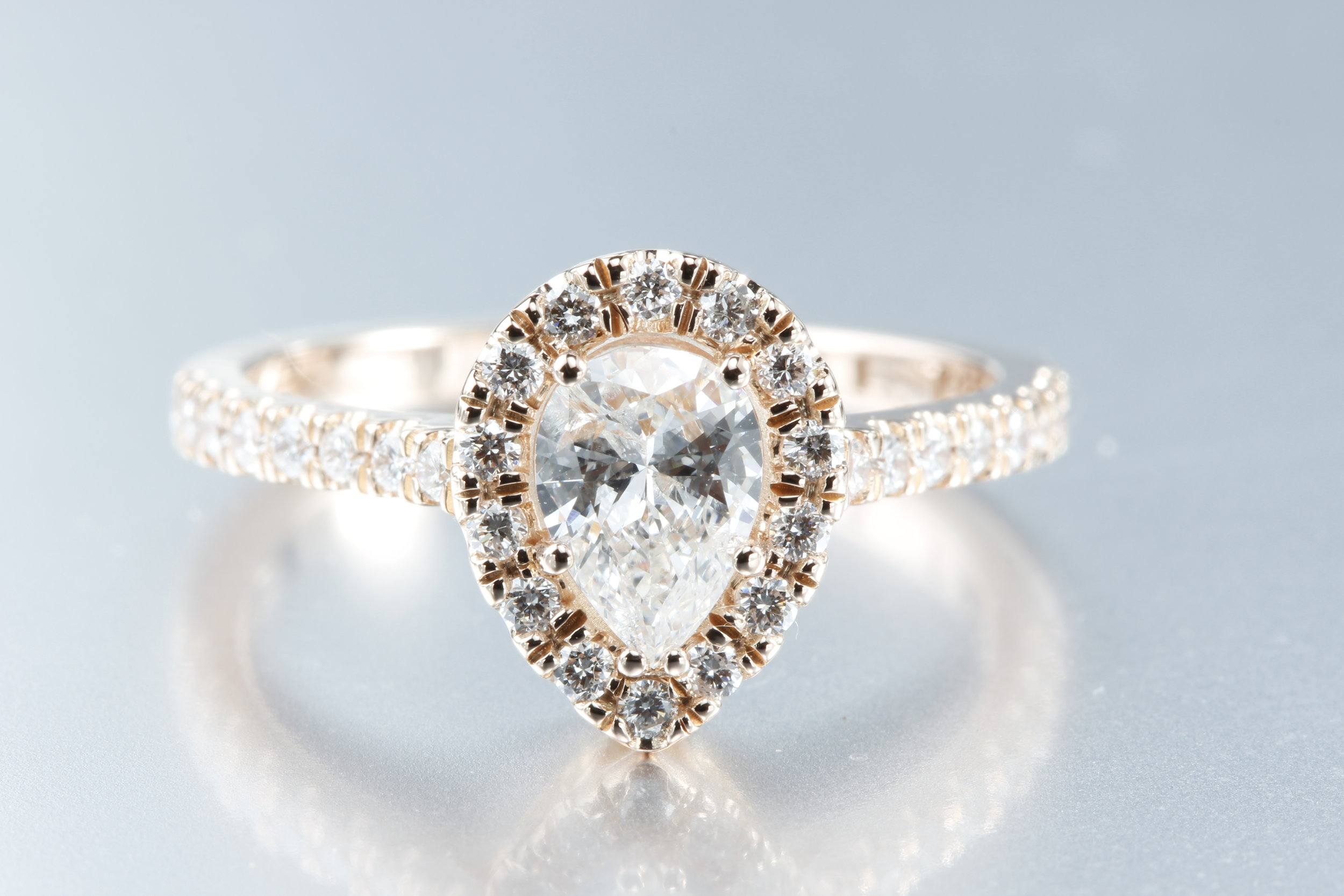 Pear Diamond Halo Ring with 14K Rose Gold - This vintage-inspired ring is stunning with its simplicity.