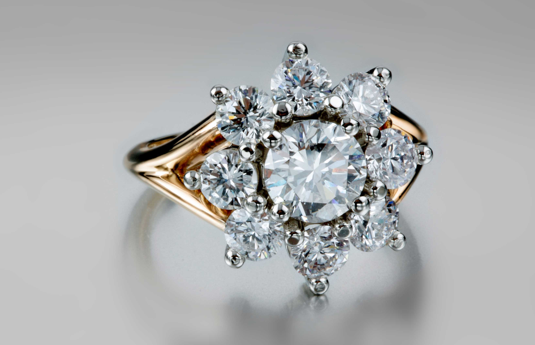 Floral Cluster Diamond in 14K Yellow Gold - 9 Genuine Diamonds in the shape of a flower with a split shank in 14K yellow gold.
