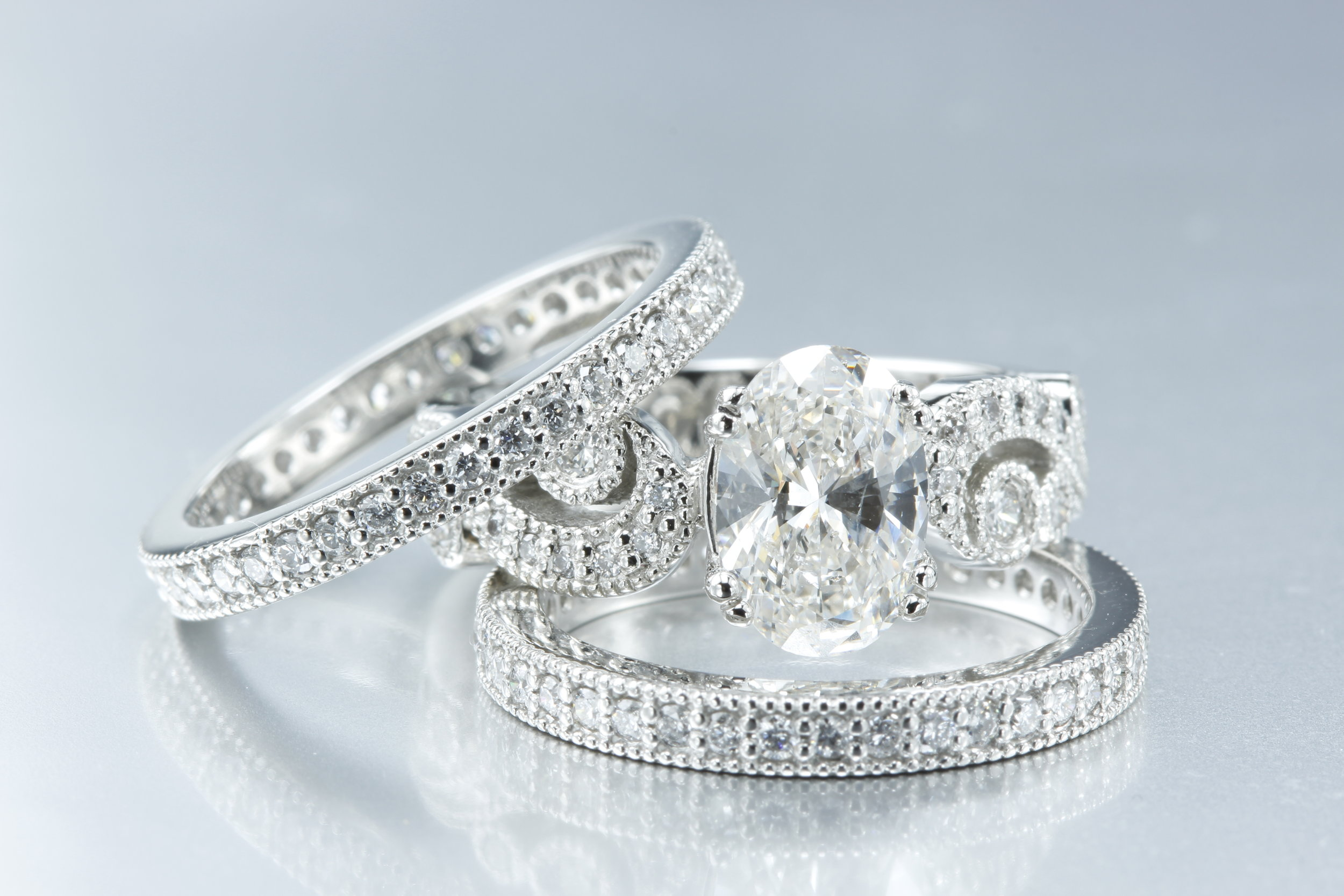 Oval Diamond Center Stone - 3 Piece Set - Paisley design along the band in this oval engagement ring set.