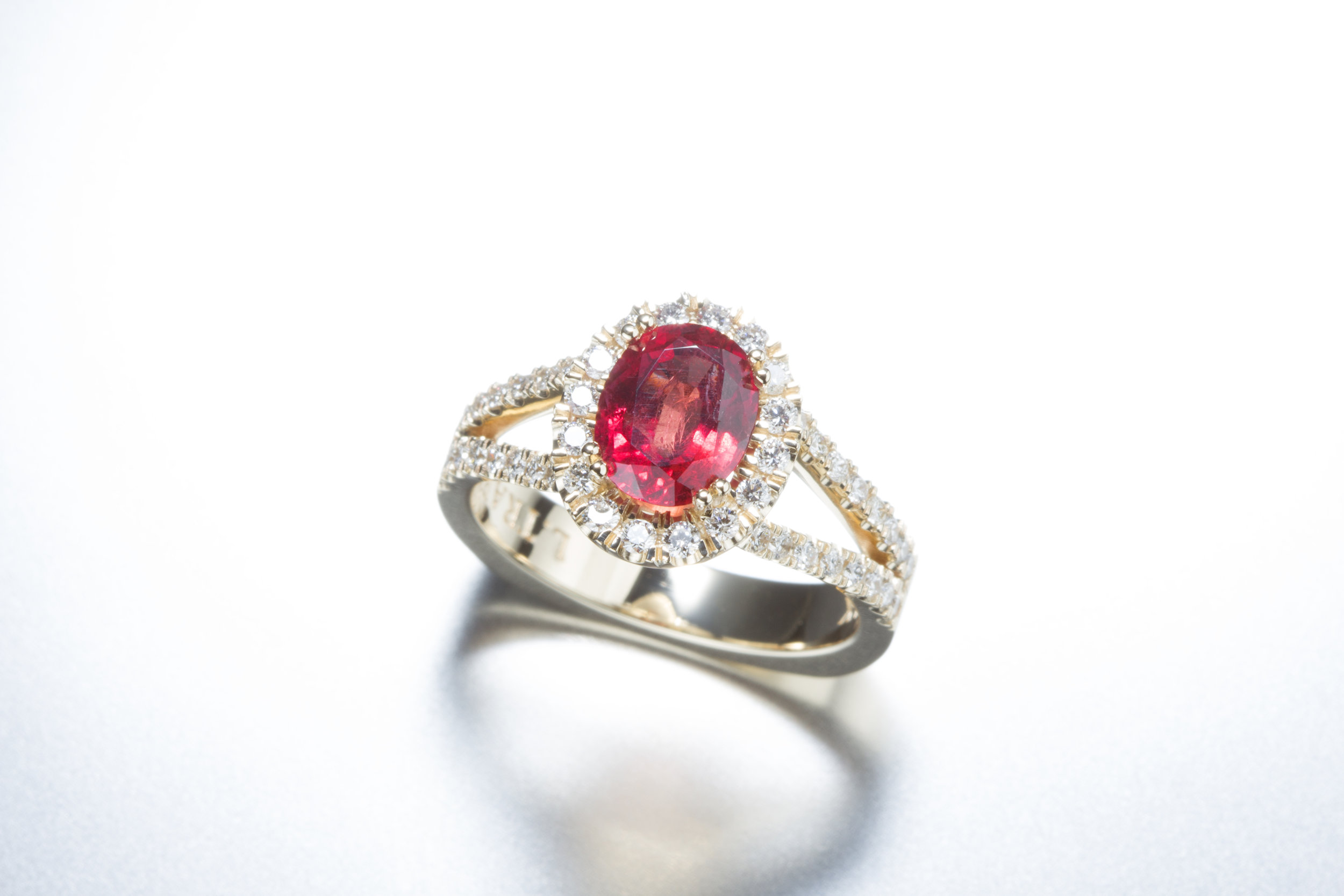 Ruby and Diamond 14K Yellow Gold - A ruby ring that pops with color. Conflict-free and genuine diamonds line the yellow gold band.