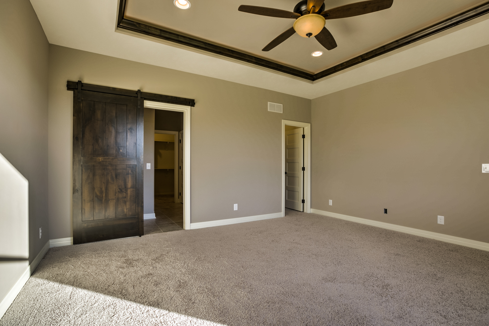 - Sliding Barn door into the bathroom from the master bedroom. 2 master bedroom closets.