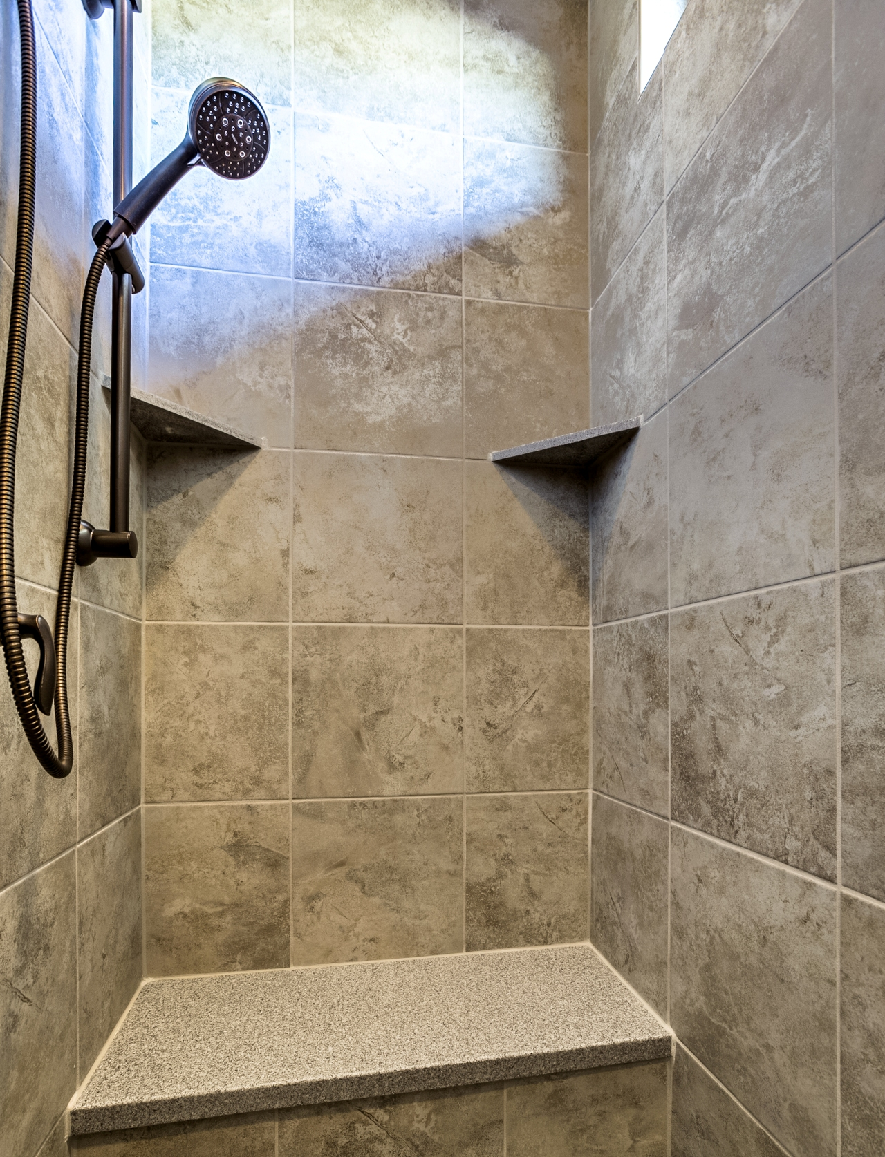Walk in tile shower with transom window and rain head