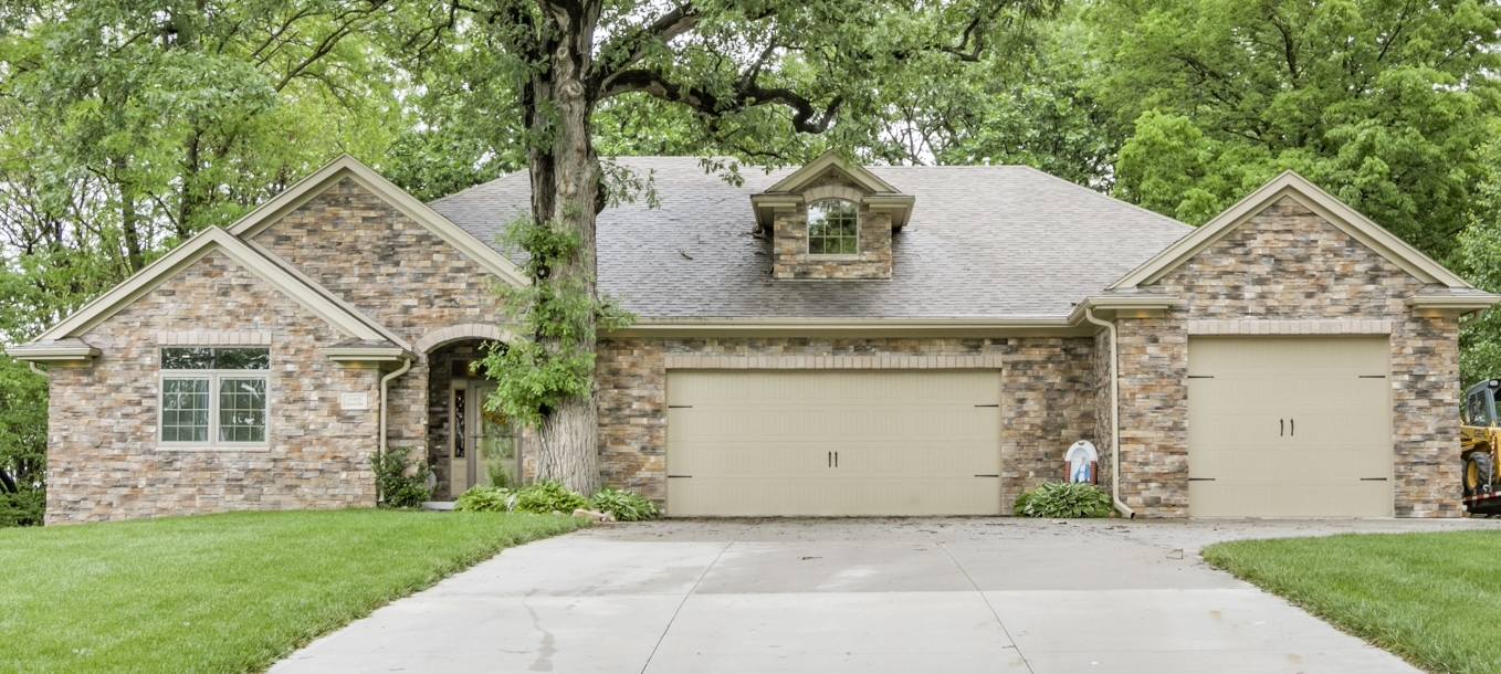 Sold    109 bellevue Blvd   Stunning stone front walkout ranch with an over sized heated 4 car garage. Main level includes 3 bedrooms or 2 plus an office.
