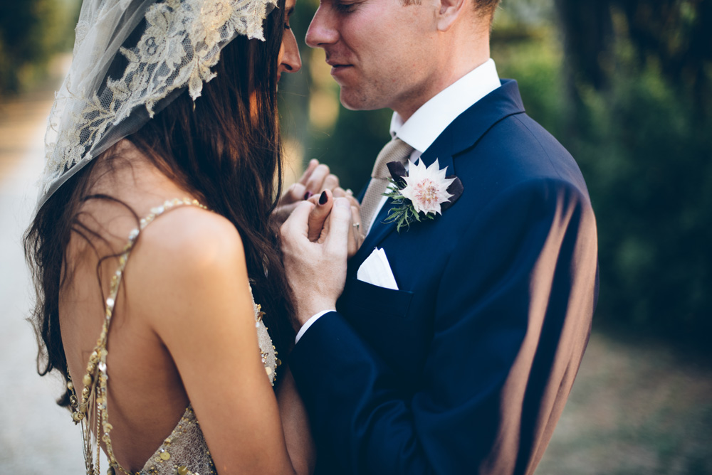 Capped veil and backless dress