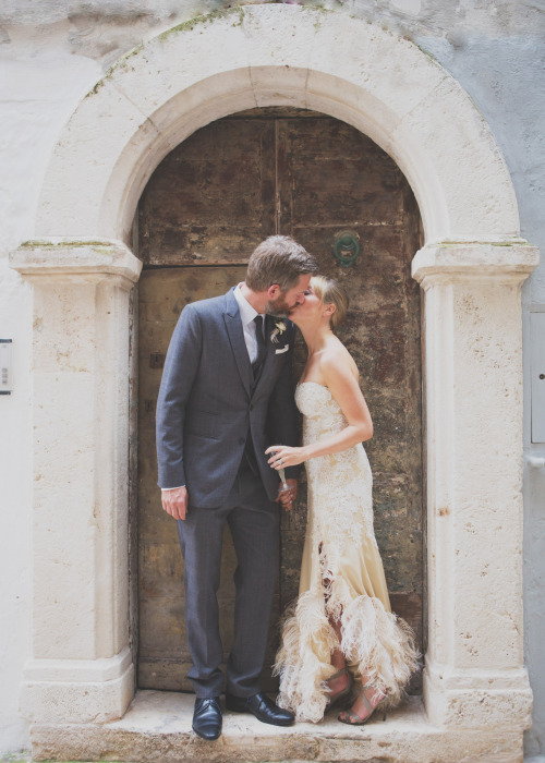 gold and white lace feather wedding dress with thigh split