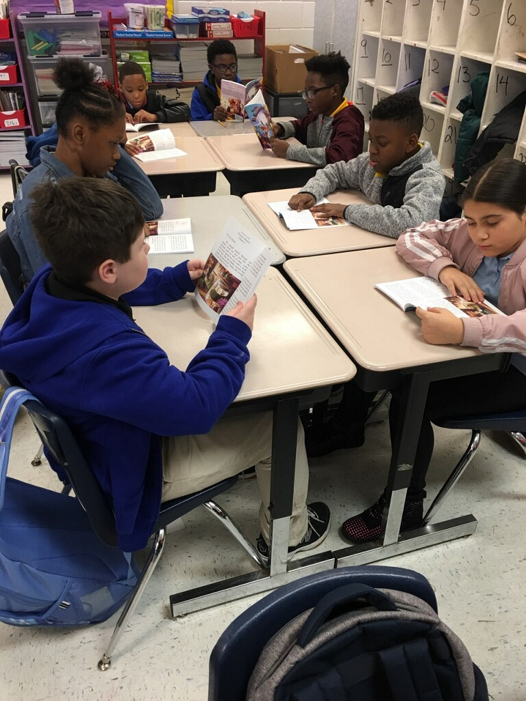 CHILDREN READING SALLY SAVER.jpeg