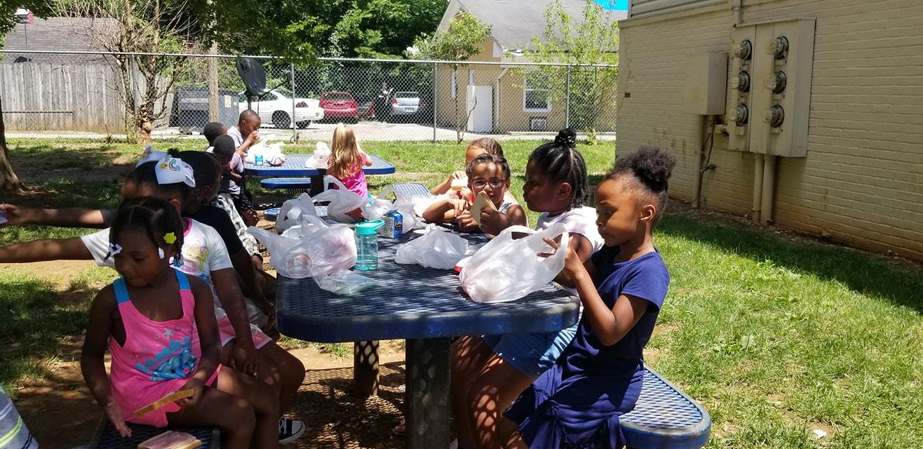 children eating at table food program 2.jpg