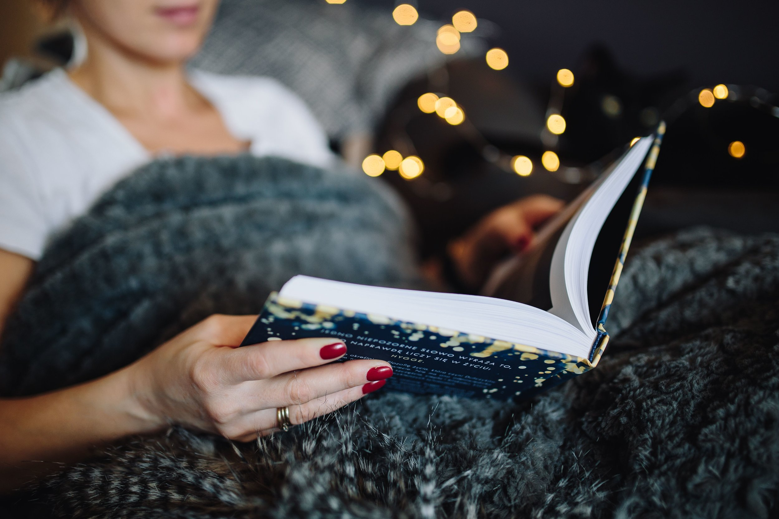 kaboompics_Young woman at home reading Hygge book and drinking.jpg