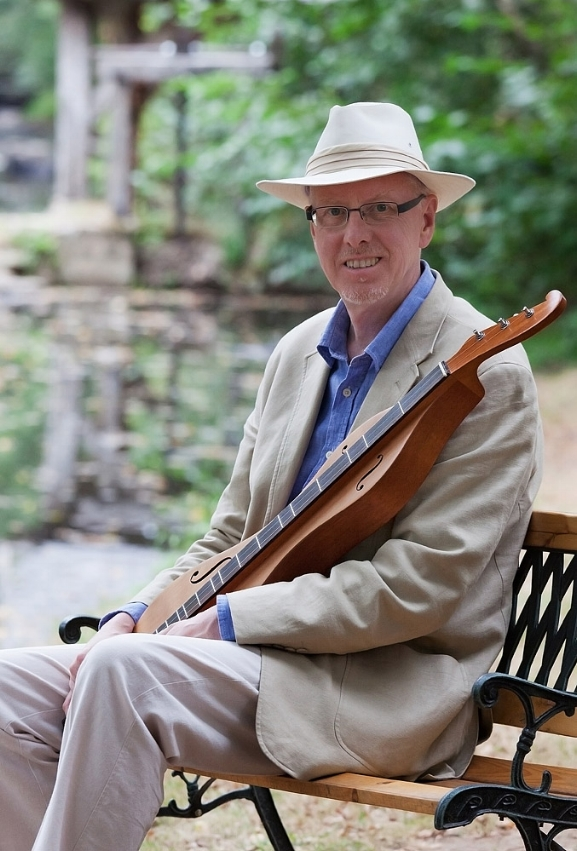 Dan seated with dulcimer and hat.jpg