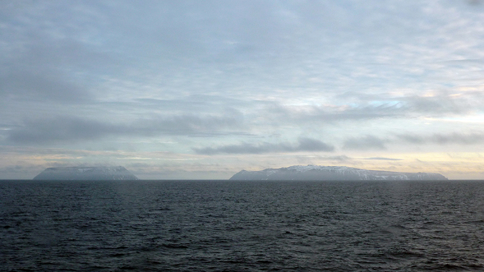 Little Diomede (left) and Big Diomede (right) islands under the midnight sun as we searched for the two lost men. Photo credit: Catherine Pham
