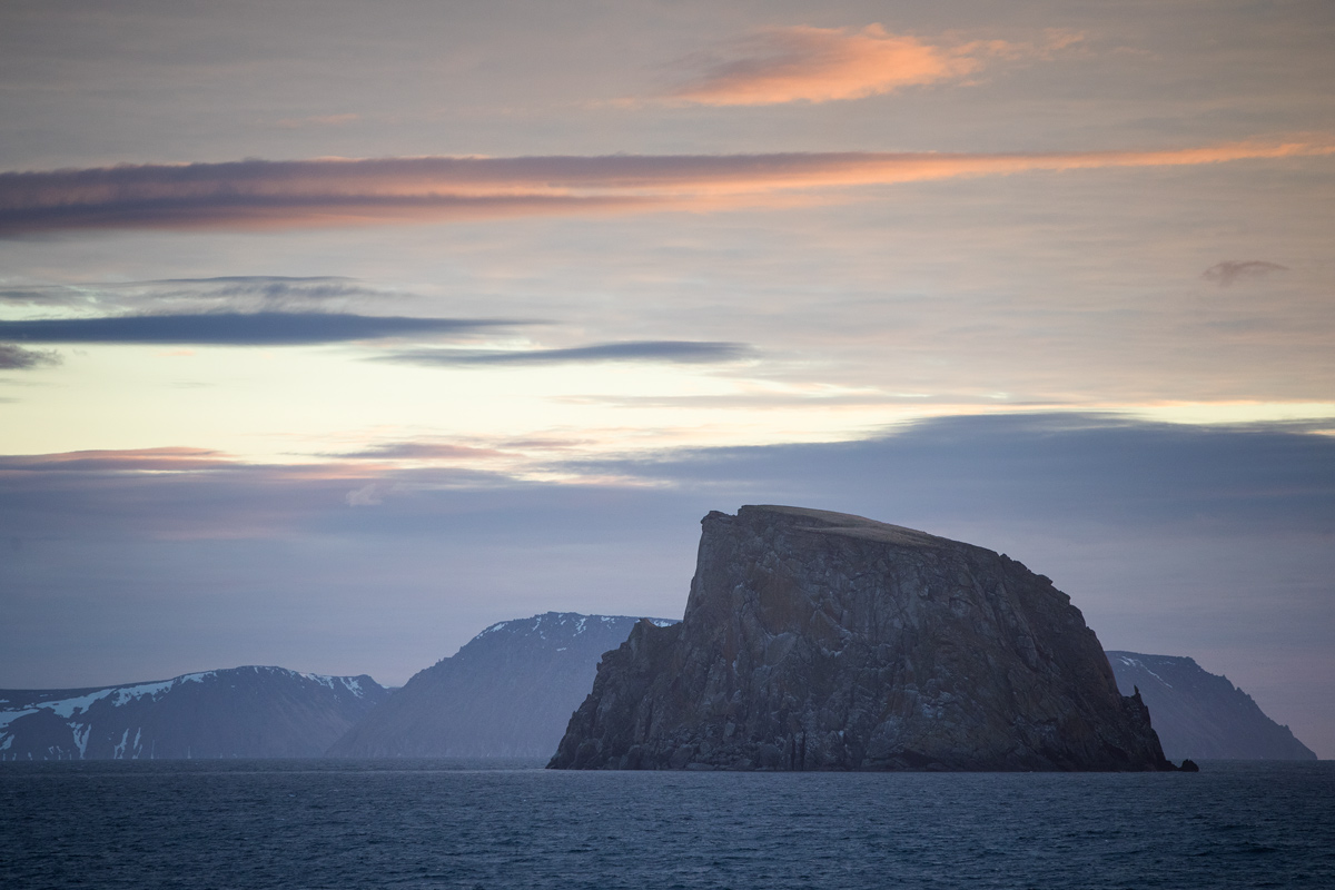Early morning sunset over the Diomedes and Fairweather Rock. Photo credit: Brendan Smith