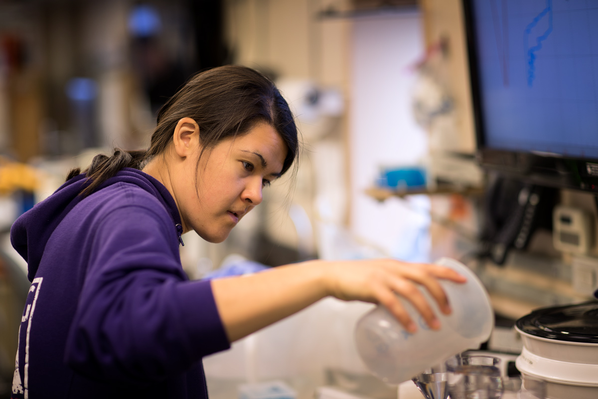 Rachel starting her water filtration from a sample collected in a niskin bottle. Photo credit: Brendan Smith