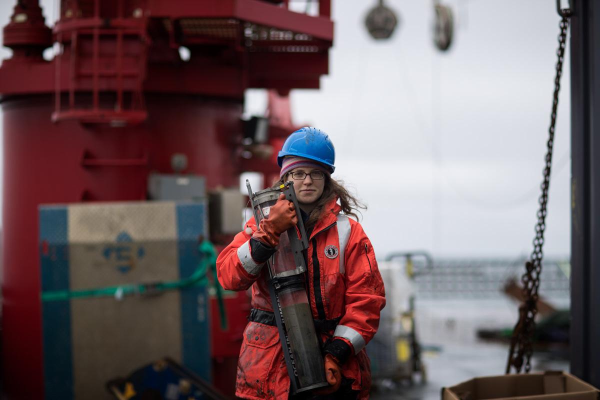 Brittany Jones carrying a sediment core after a recent multi-core deployment. Photo credit: Brendan Smith