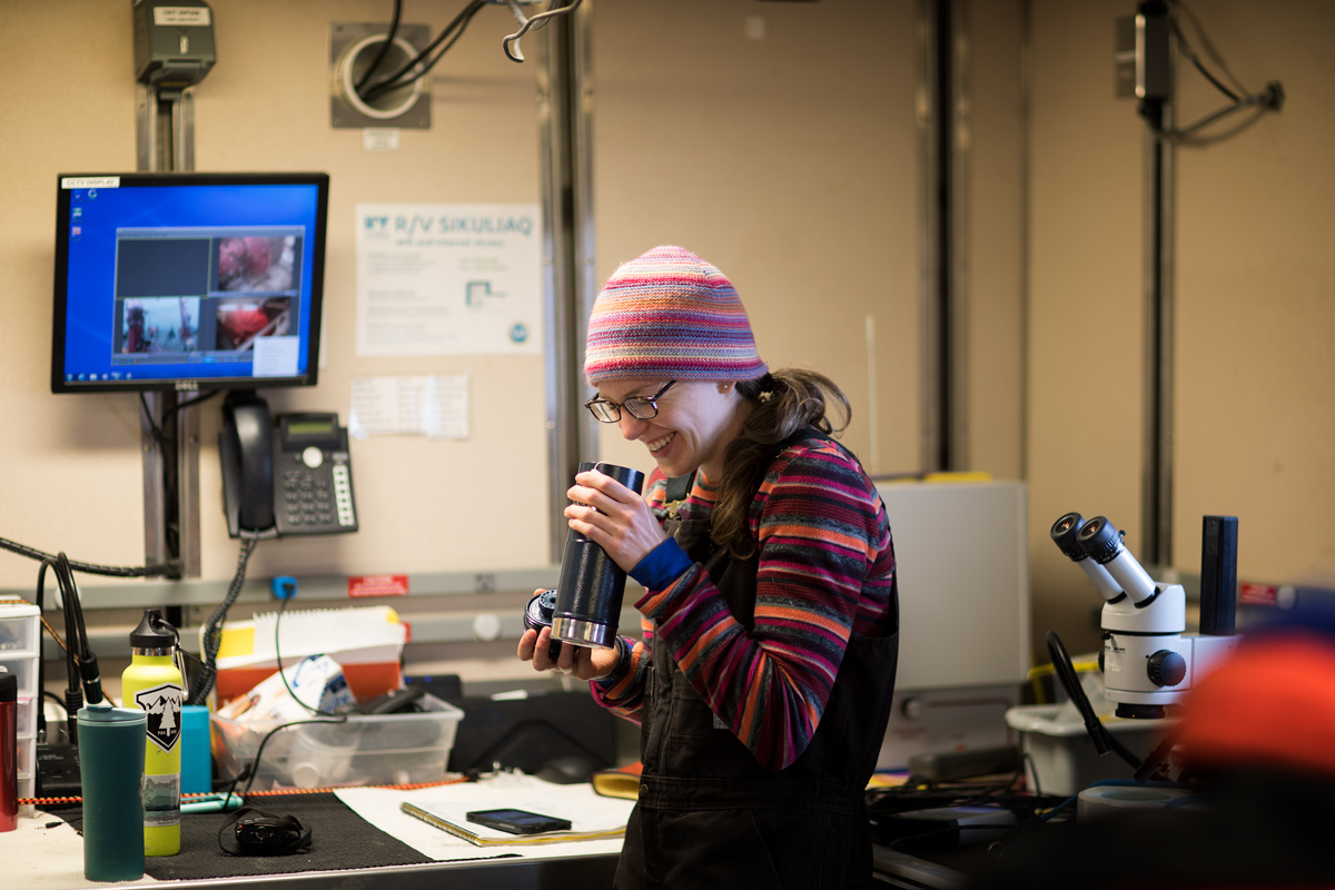 Easy to laugh, Brittany holds a thermos of tea to stay warm. Photo credit: Brendan Smith