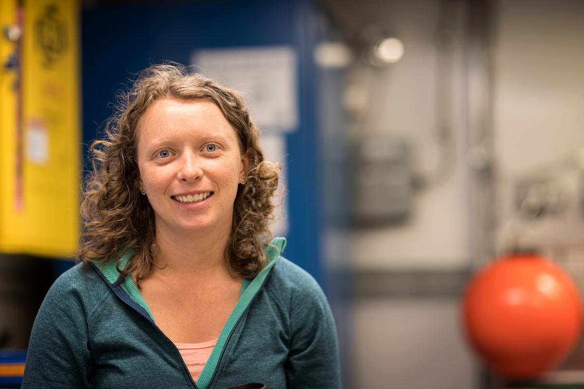 Portrait of Stephanie O'Daly by her lab station. Photo credit: Brendan Smith