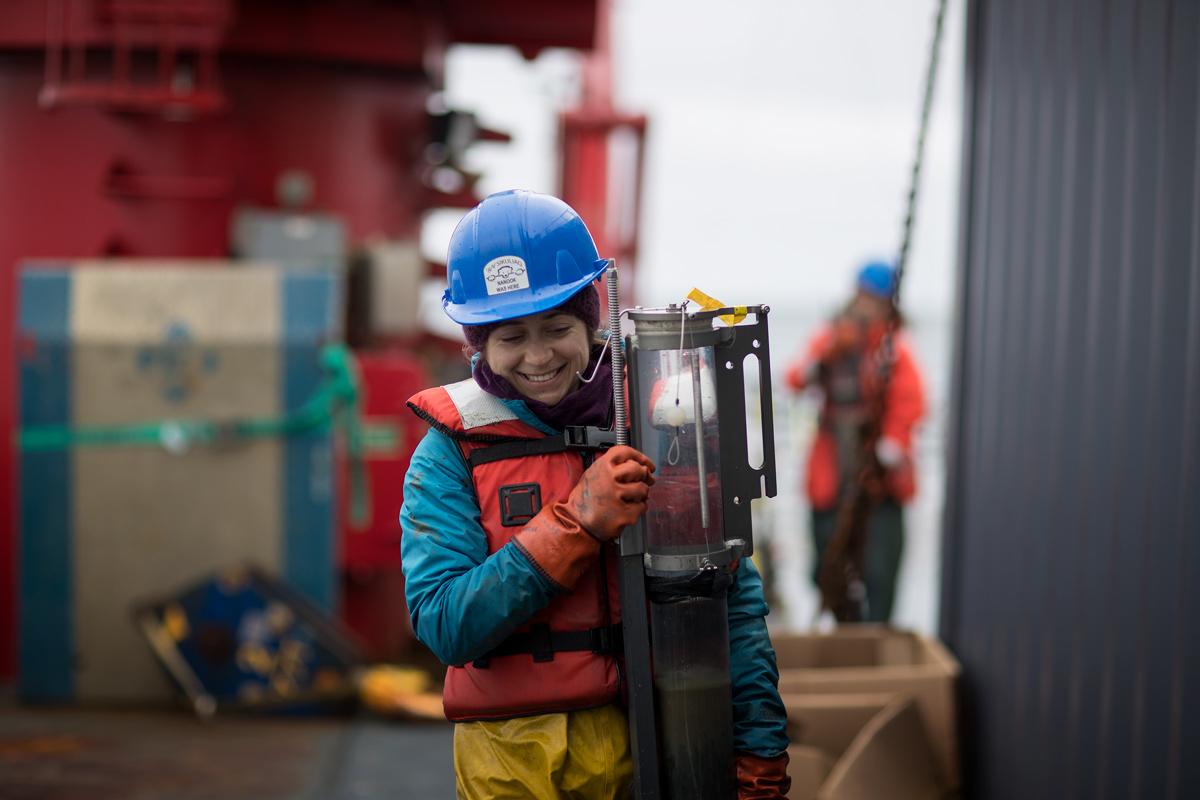 Bringing in a sediment core from a recent multi-core deployment. Photo credit: Brendan Smith
