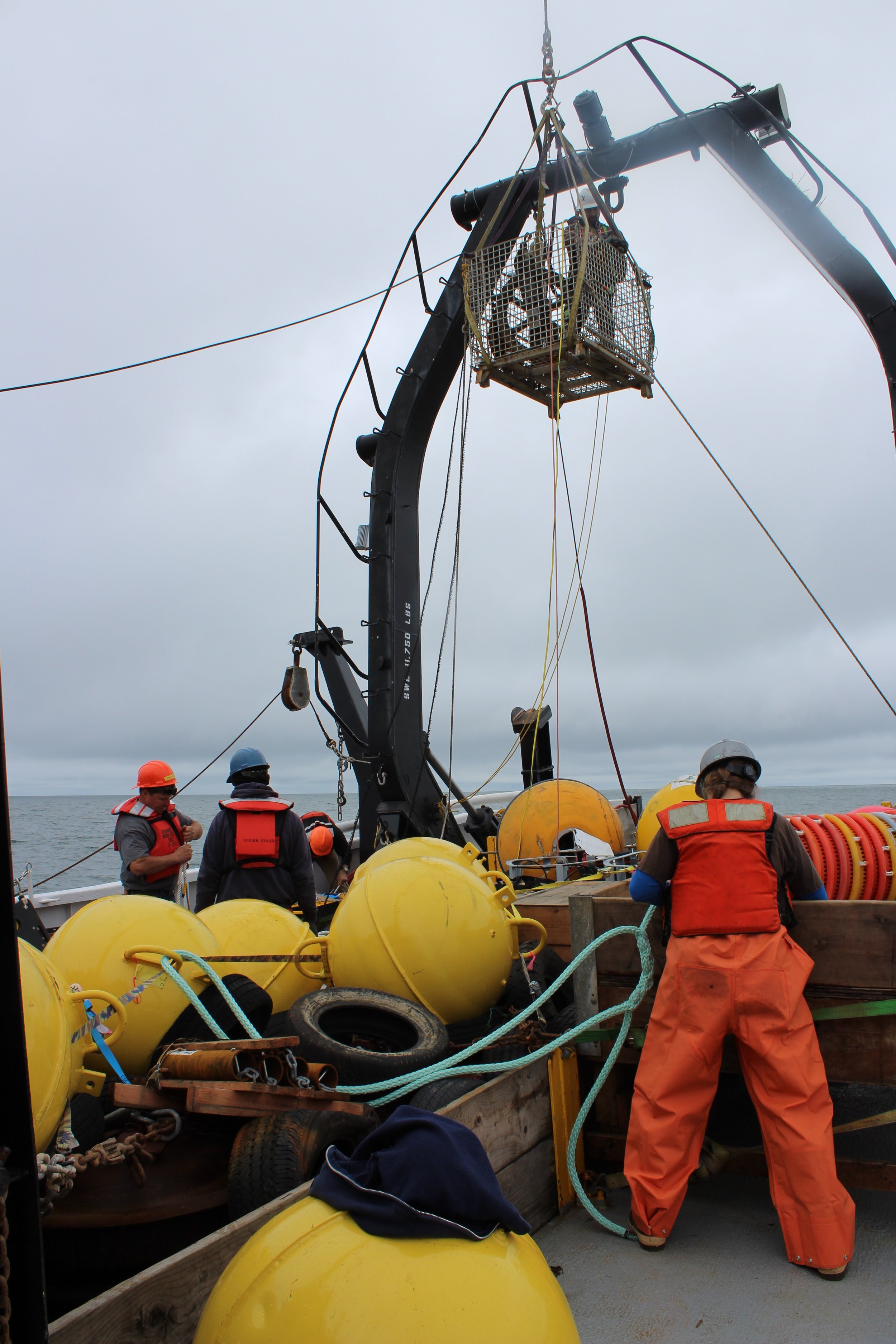 Catherine Berchok splices line for bridles of mooring buoys;Armando Urrutia repairs the A- frame;Geoff Lebon and crew prepare moorings.Photo credit: Harmony Wayner