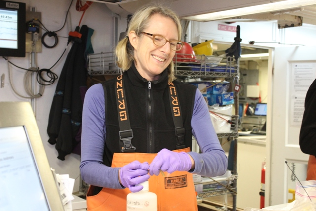 Libby Logerwell hard at work aboard the R/V  Ocean Starr . Photo credit: Ed Farley