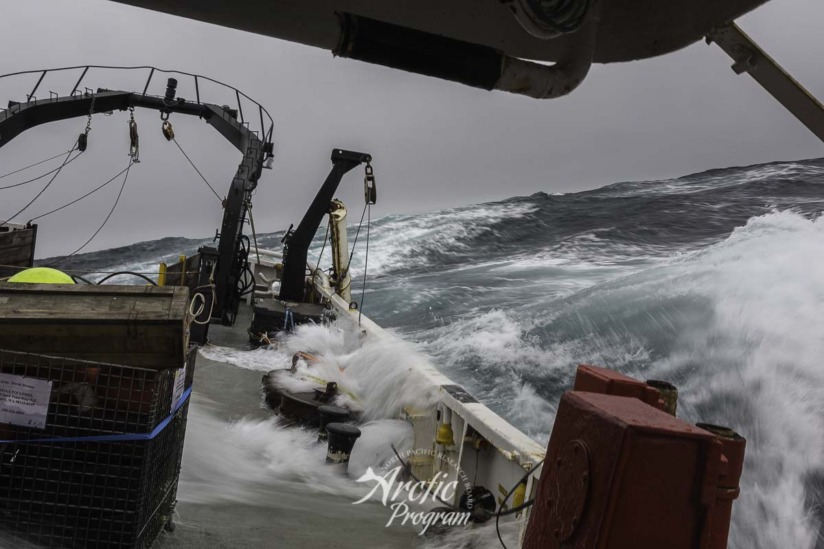 Waves wash the deck as the  R/V Ocean Starr  heads north through the Bering Sea. Photo credit: Brendan Smith/NPRB