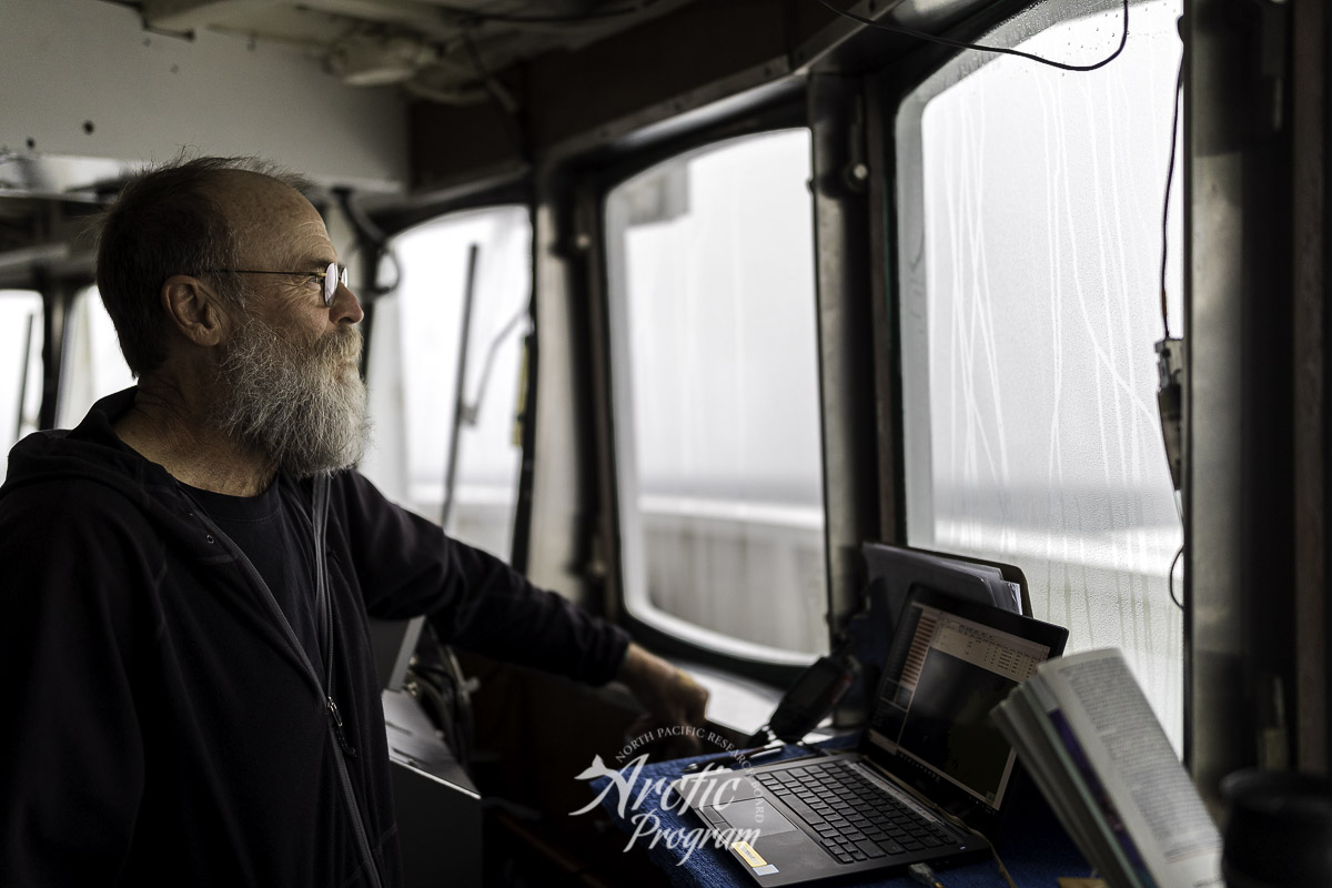Marty Reedy scanning the 300m square grid off the starboard bow for any sea bird activity. Photo credit: Brendan Smith/NPRB