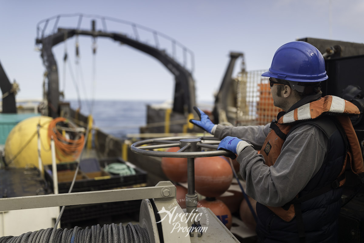 Scientist Dave Strauss guiding the dragging wire for a missing mooring buoy. Photo credit: Brendan Smith/NPRB