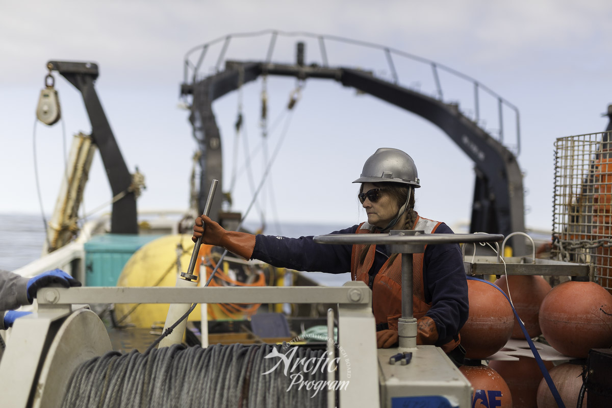 Catherine Berchok guiding the dragging wire back into the spool of the winch. Photo credit: Brendan Smith/NPRB