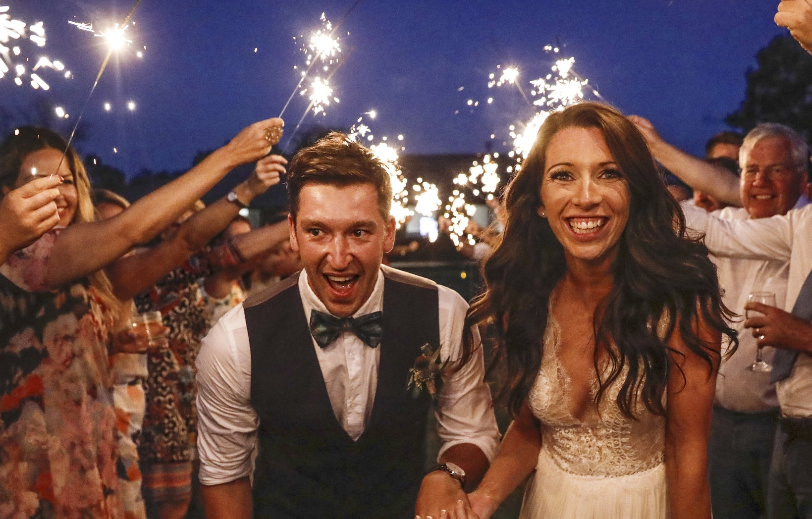 Bride and Groom running through sparklers on their wedding day