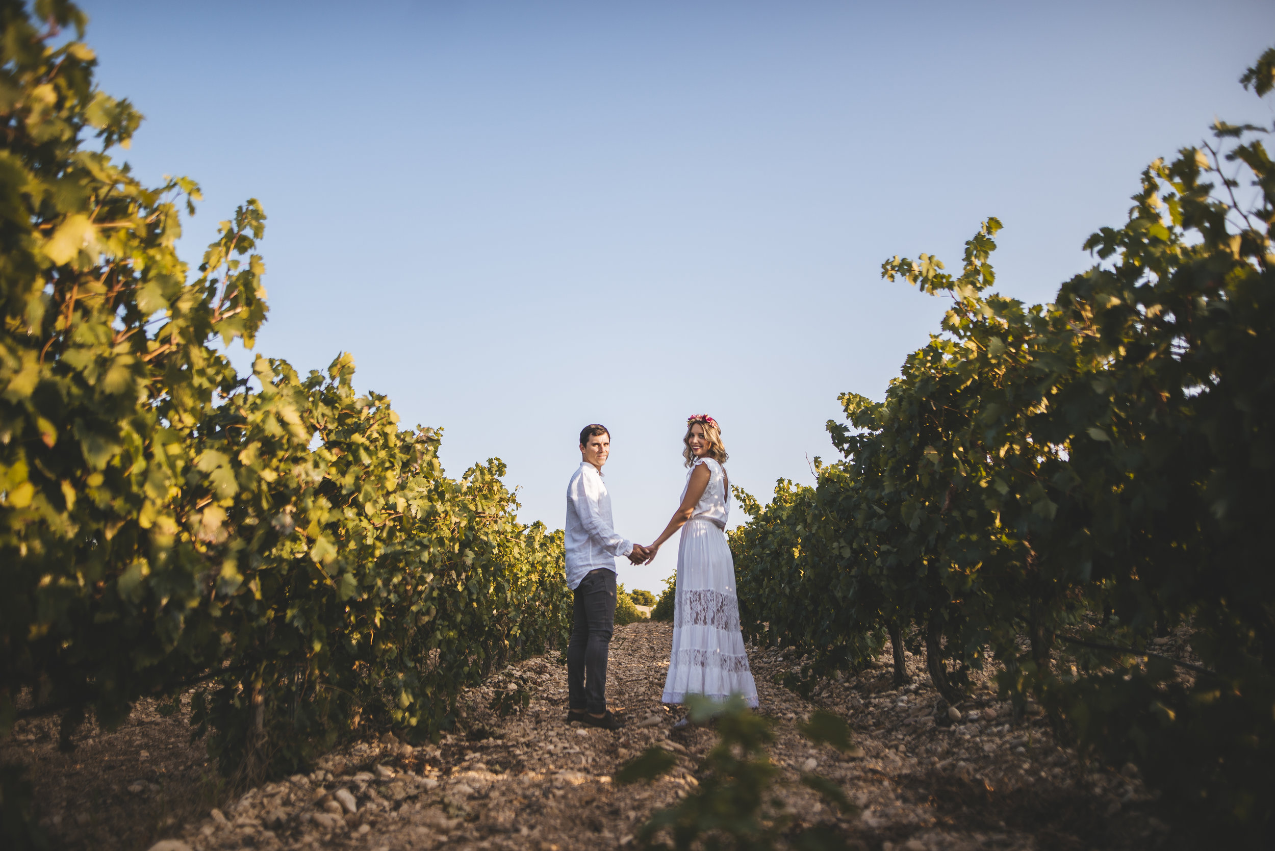 Bride and Groom on their wedding day in a vineyard