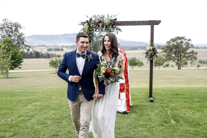 Bride and Groom walking down the aisle Hunter Valley Wedding